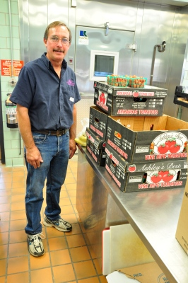 Marty Ruhlig delivering cherry tomatoes for school meals.