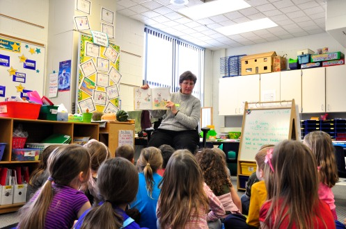 "Deb Lentz of Tantre Farm reading students ""Sophie's Squash"", a story about a girl with a Butternut Squash friend, named Bernice."