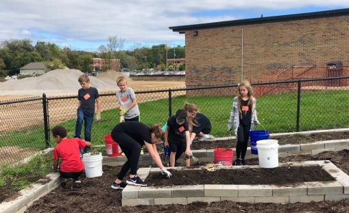 6th grade flex students help winterize the Sullivan Memorial Garden